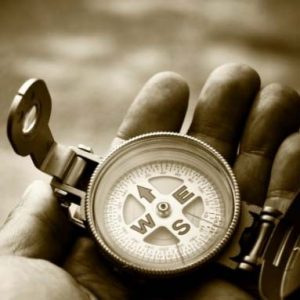 Image of a hand with a compass